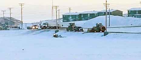 Hamlet vehicles block the road as two front-end loaders arrive to try and pull out a hamlet CAT bulldozer that crashed through the ice on Williamson Lake in Rankin Inlet on Nov. 15, 2018. Darrell Greer/NNSL photo