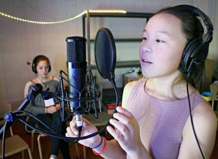 Mia Autut lays down a vocal track to one of the songs produced by a group of students and the Darkspark team in Rankin Inlet on Dec. 1, 2018. Photo courtesy Darkspot
