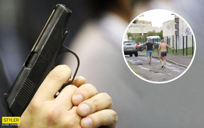 Голий але озброєний! По столичній Троєщині розгулює напівголий чоловік з пістолетом
