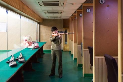 """Kim Hyang, 22 years old, works at the """"Meari Shooting Range"""" of Pyongyang."""