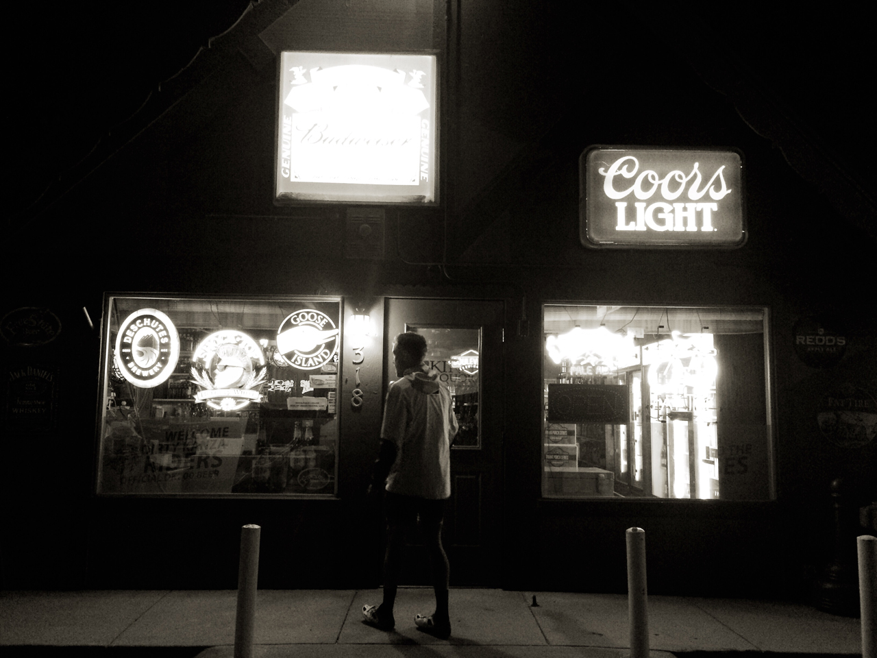 Mothra bashes up against the light of a liquor store. Closed at 9. It is 9:10pm. DENIED!