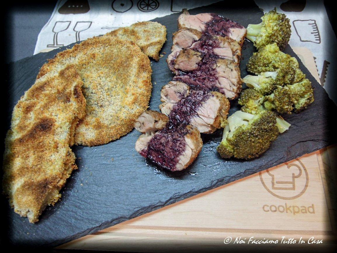 Filetto di maiale alle spezie con salsa al vino rosso accompagnato con mazze di tamburo e broccoletti