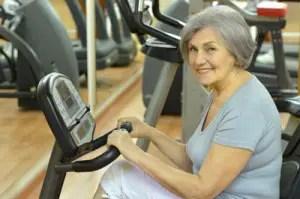 © Aletia | Dreamstime.com - Senior Woman Exercising In Gym Photo