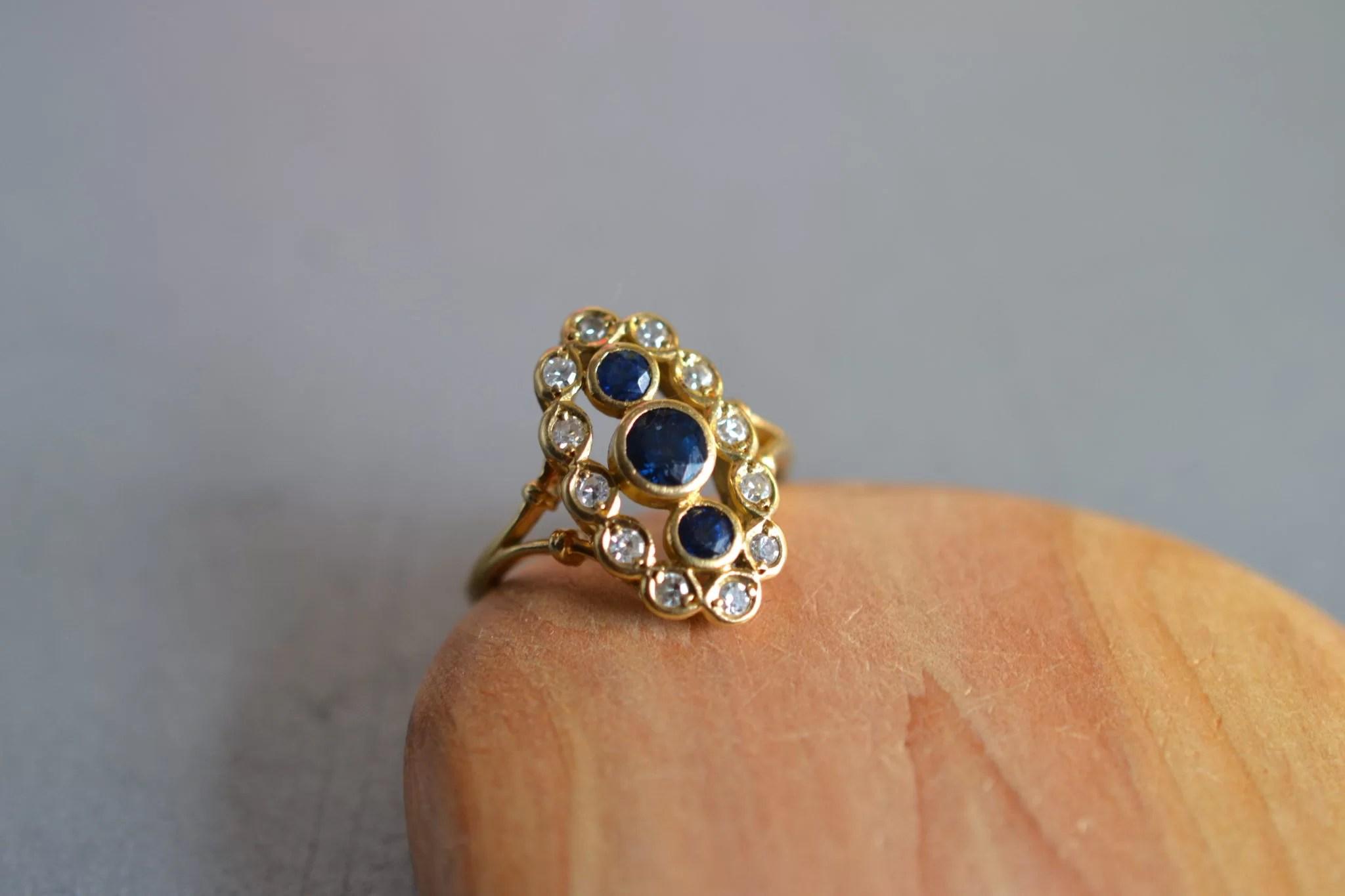 bague marquise saphir et diamants - en OR 18 carats 750:1000 - bague de fiançailles ancienne - noircarart.fr