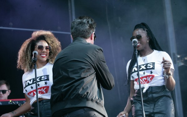 Rick Astley and his backing singing performing INXS New Sensation at A Day On The Green 2020 photo by Serge Thomann