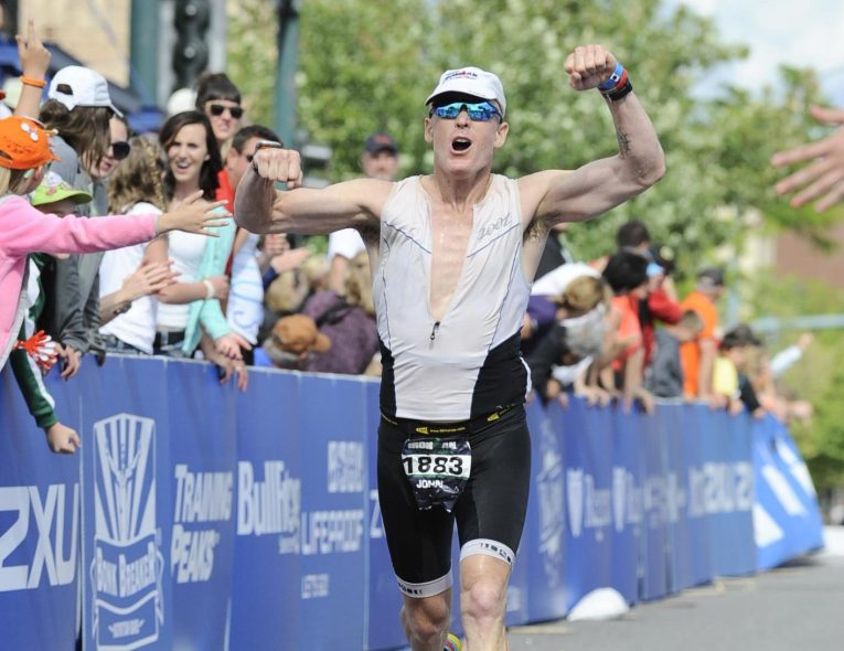 Coach John Jenkins coming in to the finish line at Ironman Coeur d'Alene in 2014.