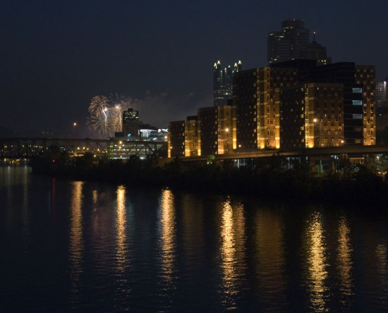 Fireworks over Pittsburgh cityscape