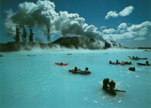 People swimming outside a geothermal plant in Iceland