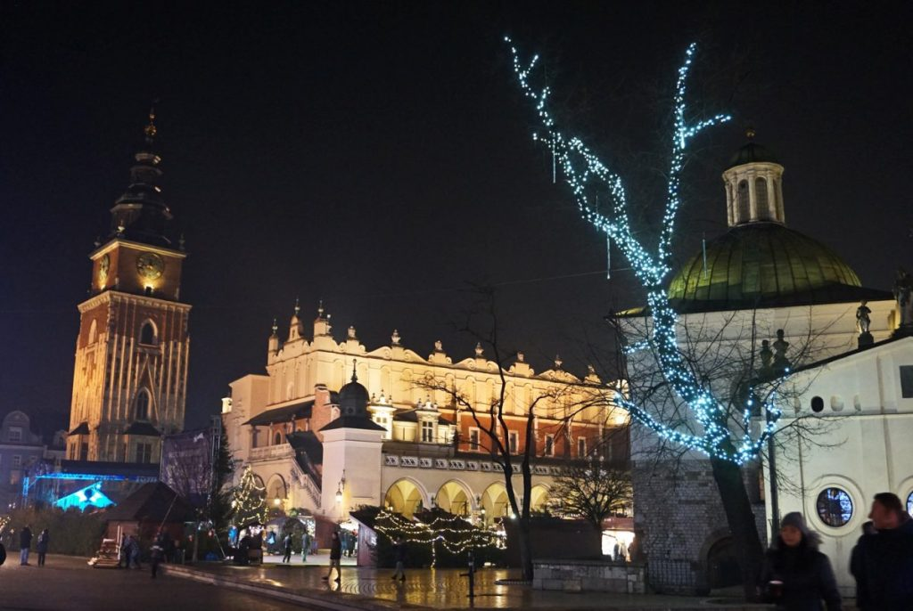 Krakow square lit up at night with Christmas decorations