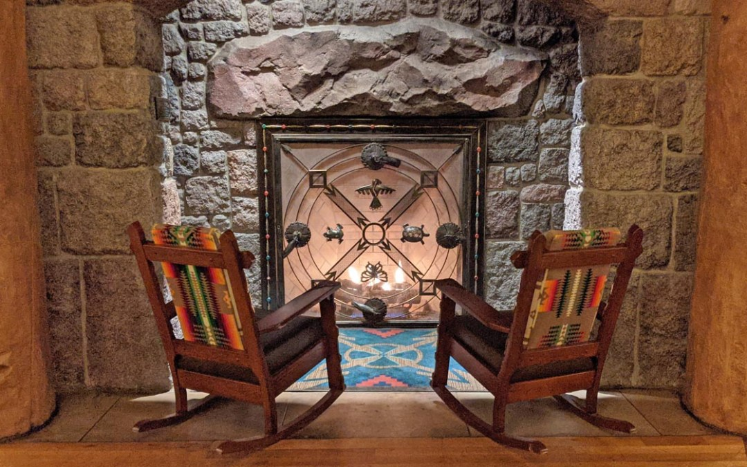 Two rocking chairs in front of a fireplace at the Boulder Ridge Villas at Disney's Wilderness Lodge