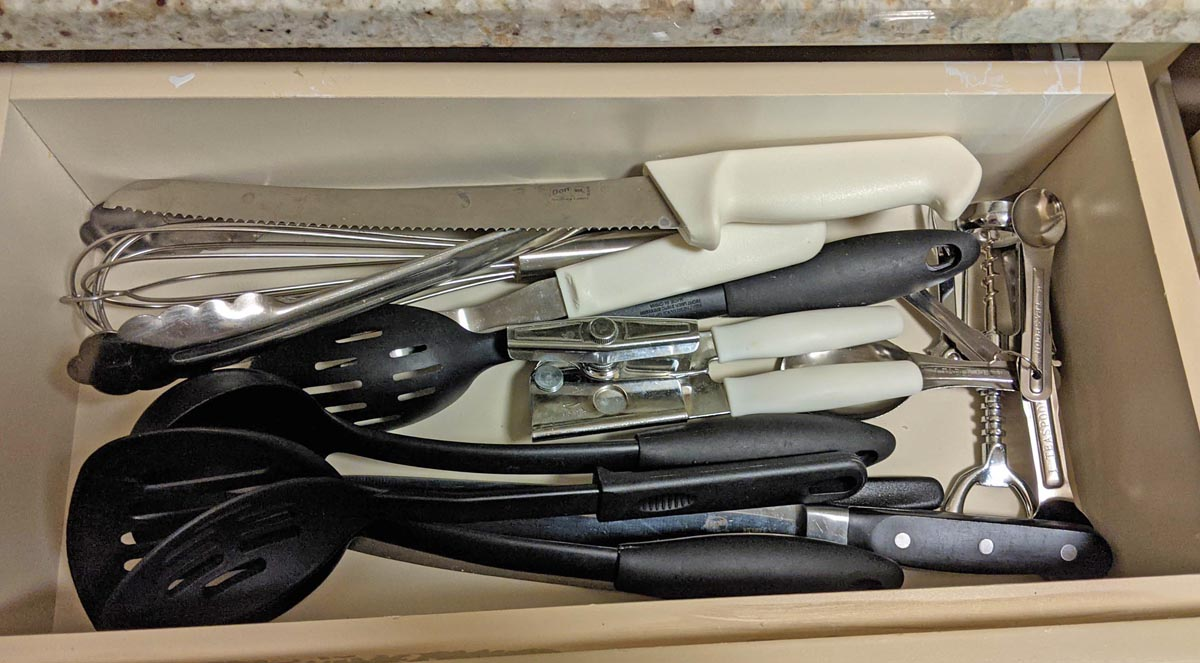 Drawer full of knives and cooking utensils