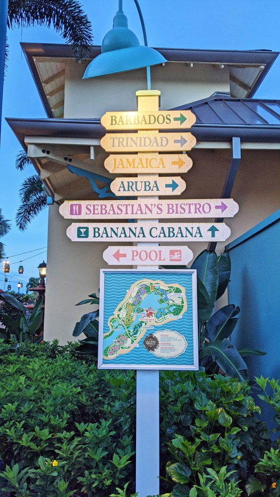 Sign listing all the themed areas at Disney's Caribbean Beach Resort