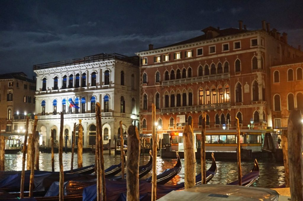 Gondolas at night in Venice, Italy