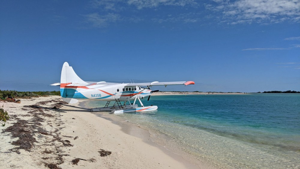 Seaplane along the sandy beach on Bush Key in the Dry Tortugas