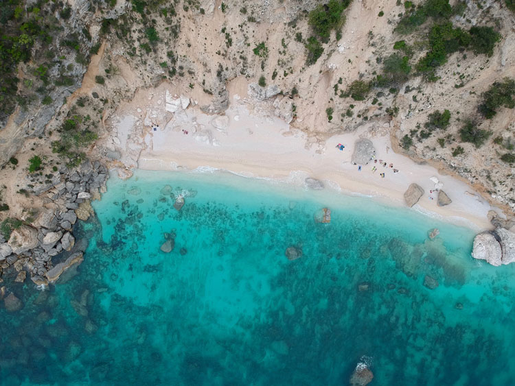 Aerial photo of turquoise waters at Golfo di Orosei in Italy