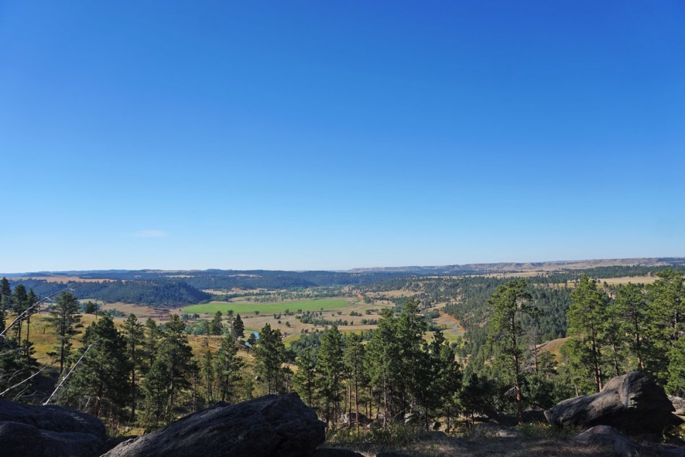 Rolling valley under a clear blue sky
