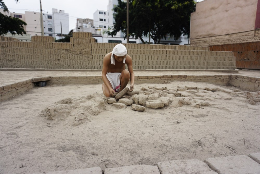 Statue depicting the creation of adobe bricks at the Huaca Pucllana archaeological site in Miraflores.