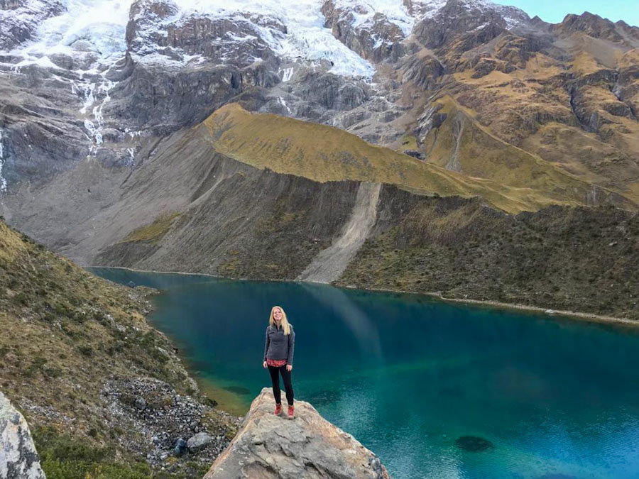 Hiker posing in front of Humantay Lake in Peru