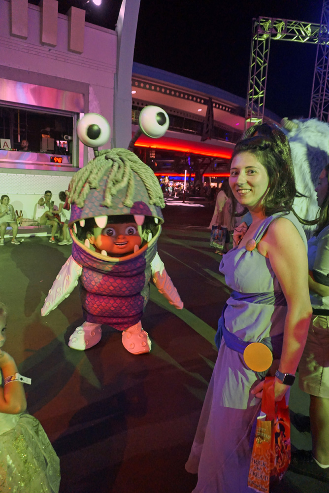 Boo from Monsters, Inc. with a woman dressed as Megara