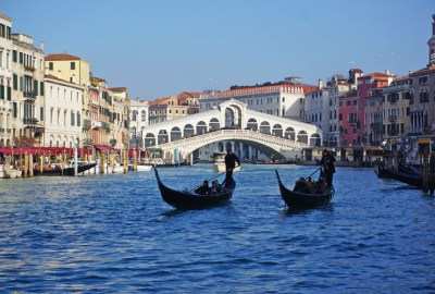 Two gondolas in the Grand Canal in front of the Rialto Bridge in Venice