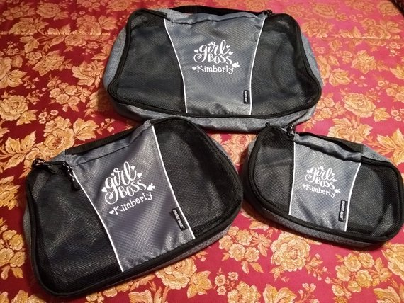 Black packing cubes with embroidery