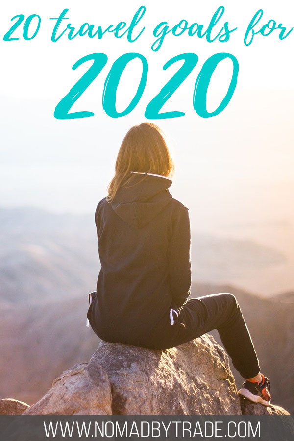 Woman sitting atop a mountain with text overlay reading 20 travel goals for 2020""