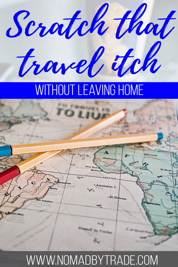 "Photo of a map with text overlay reading ""Scratch that travel itch without leaving home."""