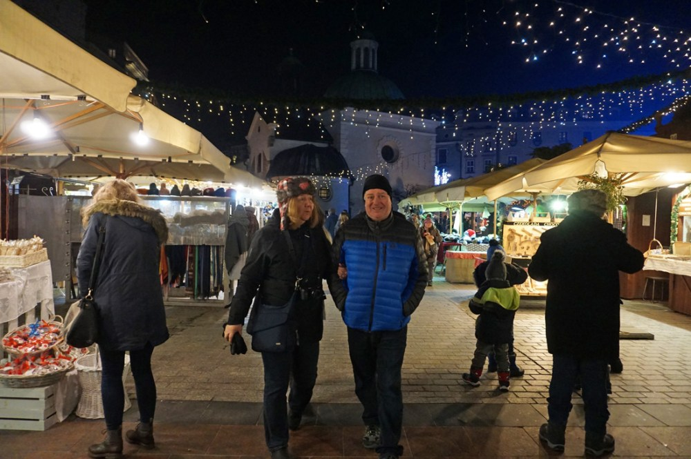 Couple walking through booths at the Krakow Christmas Market