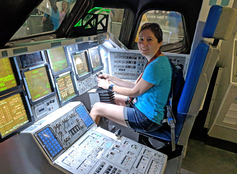 Posing inside a replica shuttle cockpit in the Kennedy Space Center