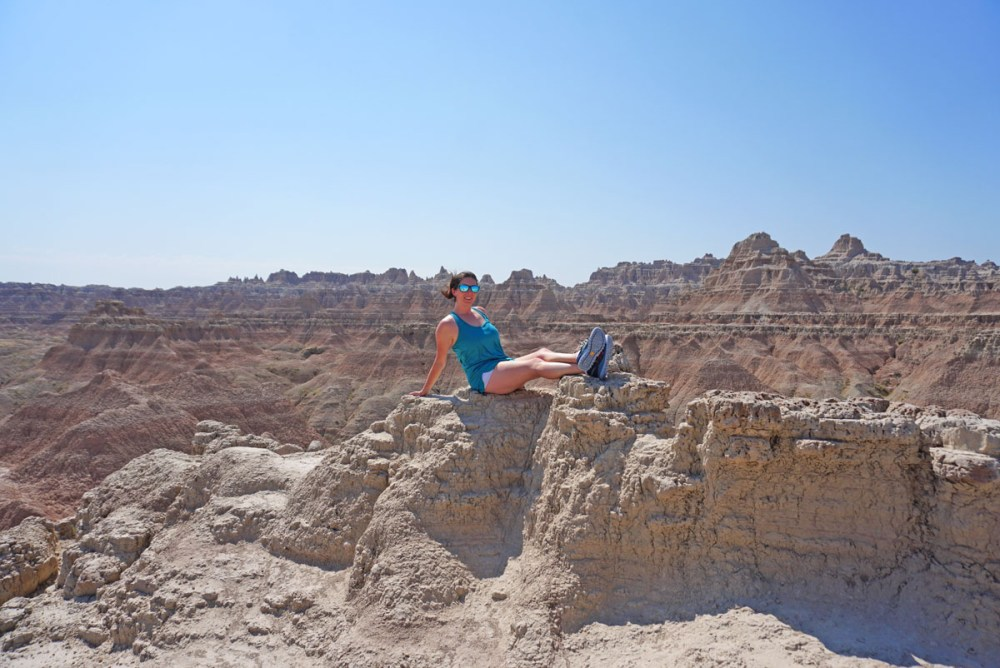 Woman posing on rocks in Badlands National Park
