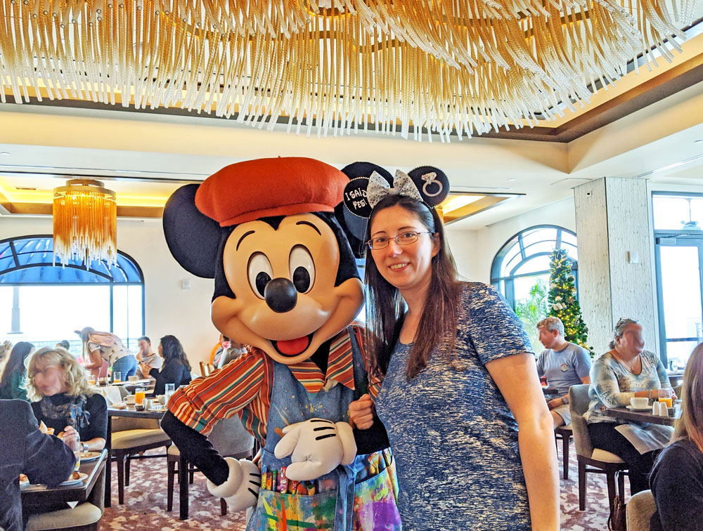 Woman posing with Mickey at Disney's Riviera's Topolino's Terrace character breakfast