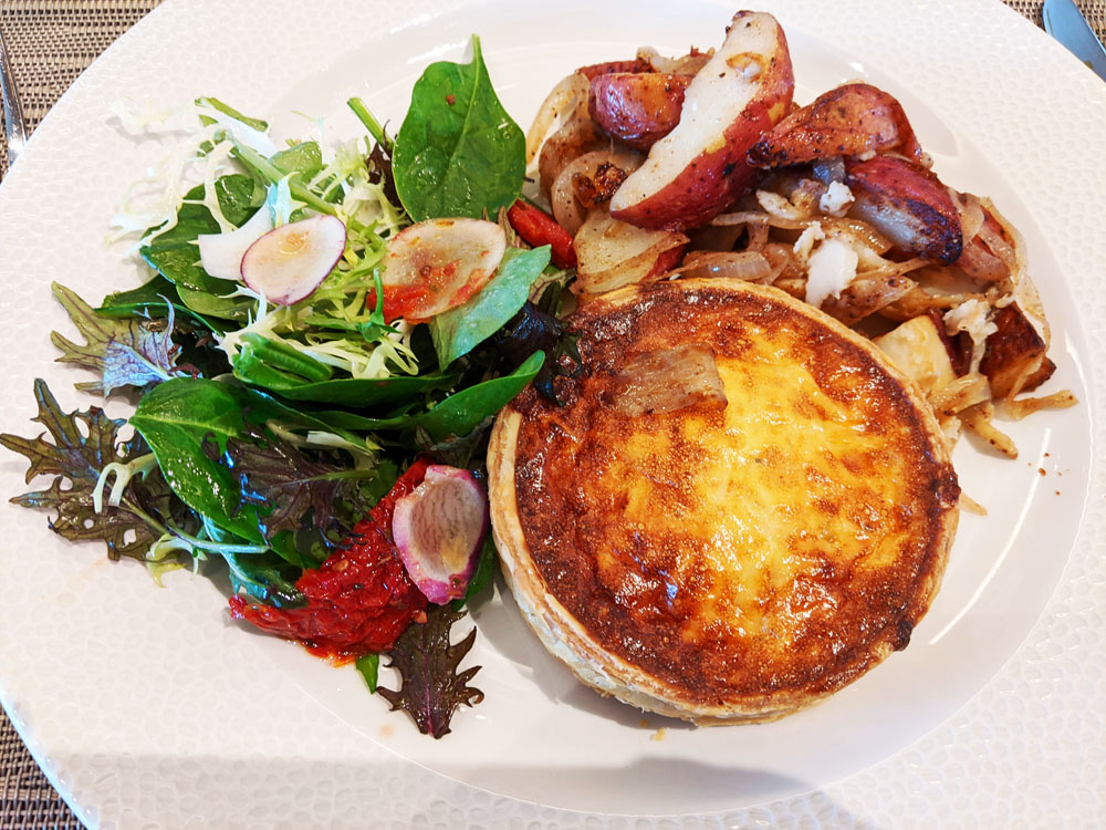Quiche guyere with potatoes and salad at Topolino's Terrace