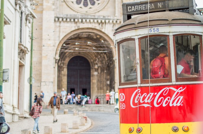 Snapshot of the famous tram 28 in front of Lisbon Cathedral.