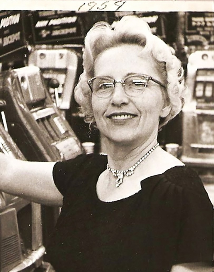 Imogene Meyer seated at a slot machine in 1959.