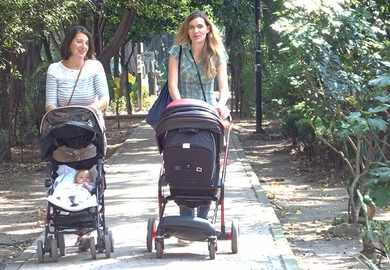 Two young mothers with baby strollers on the Avenida Amsterdam, La Condesa, Mexico City