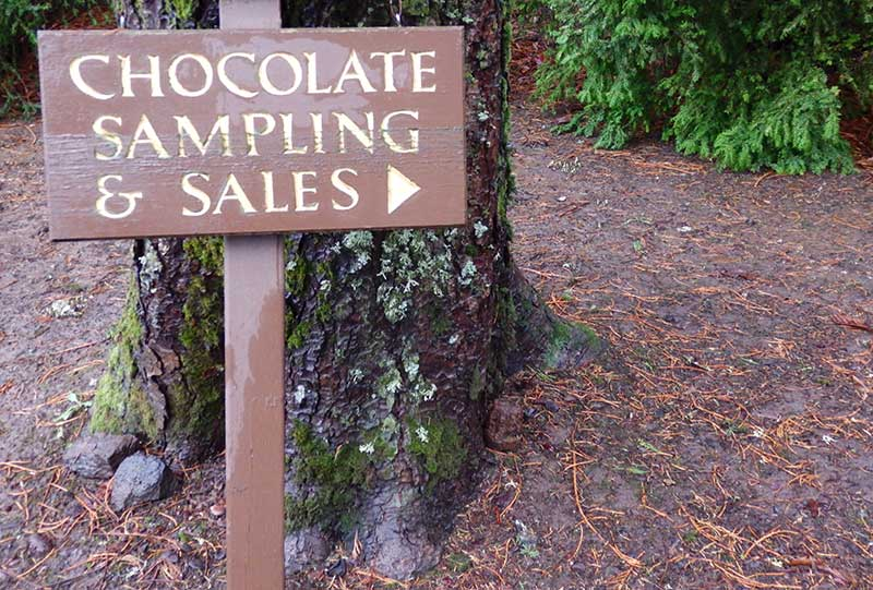 A sign points the way to chocolate samplings--fudge and the best chocolate truffles--at the Brigittine Monastery in Amity, Oregon