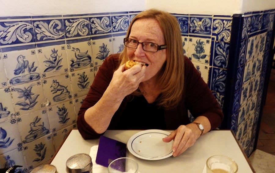 I bite into my first ever Pastéis de Belém in Lisbon, Portugal.