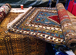 Persian-style carpets on a table at IJ-Hallen.