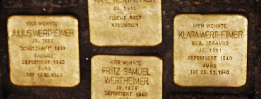 Four brass-topped solpersteine are engraved with the names, birthdates and date and place of death of four members of the Wertheimer family in Heidelberg.