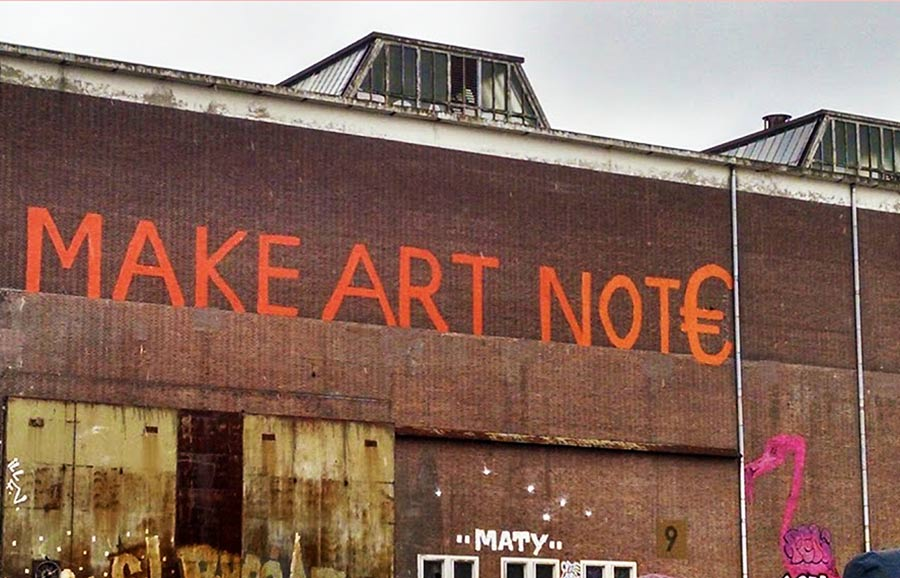 "Sign on the entrance of the IJ-Hallen flea market-""Make Art Not €"""
