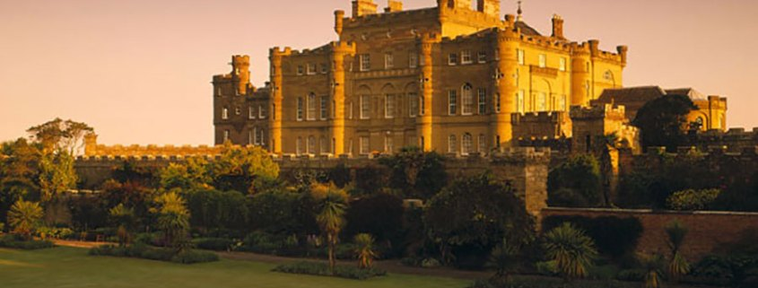 The main facade of Culzean Castle, on the Ayrshire coast of SW Scotland, glows in the warm light of the Golden Hour.