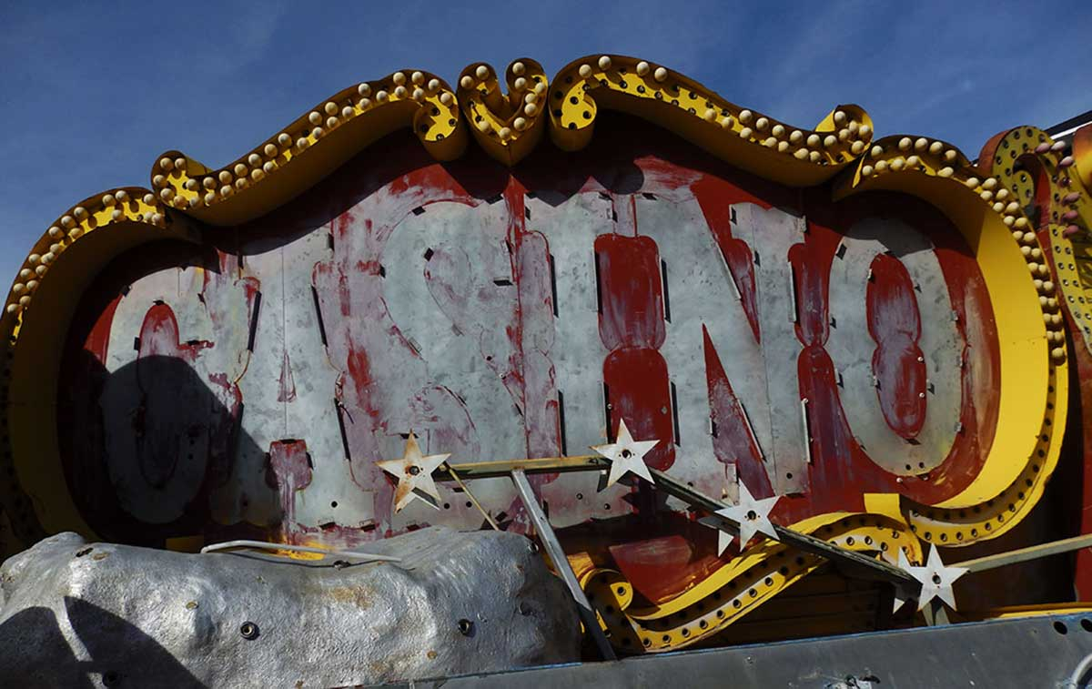 "An old and battered ""Casino"" sign in the classic circus style of old downtown Las Vegas. At the Neon Museum."