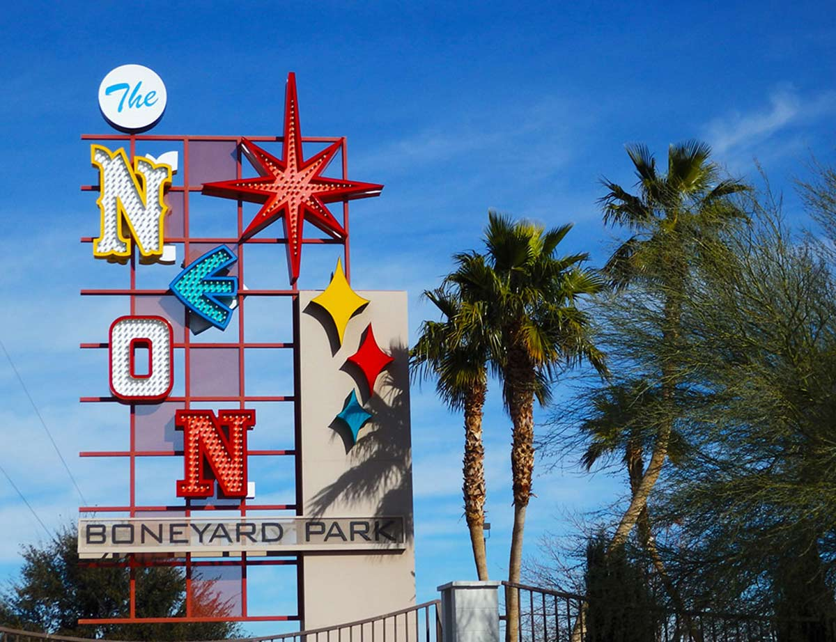 Entrance sign at the Neon Museum in Las Vegas incorporating iconic typeface letters from various Vegas locations.