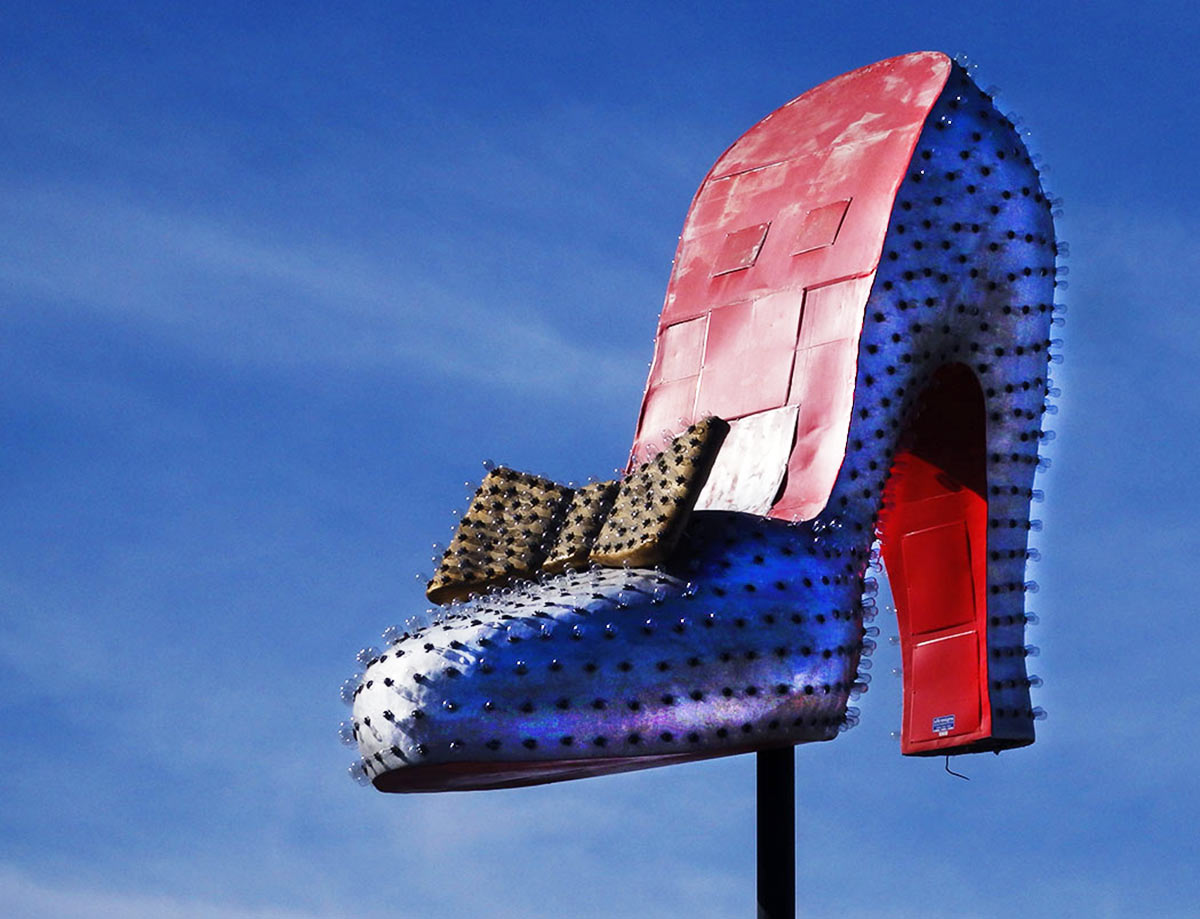 The giant Silver Slipper, perched atop its pole at the gambling hall, blinked and flashed and revolved. Now in the Boneyard of the Neon Museum, Las Vegas.