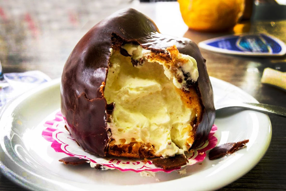 Bossche Bollen - a huge ball of the creamiest sweet cream encased in a layer of chocolate. A fabulous Dutch dessert.