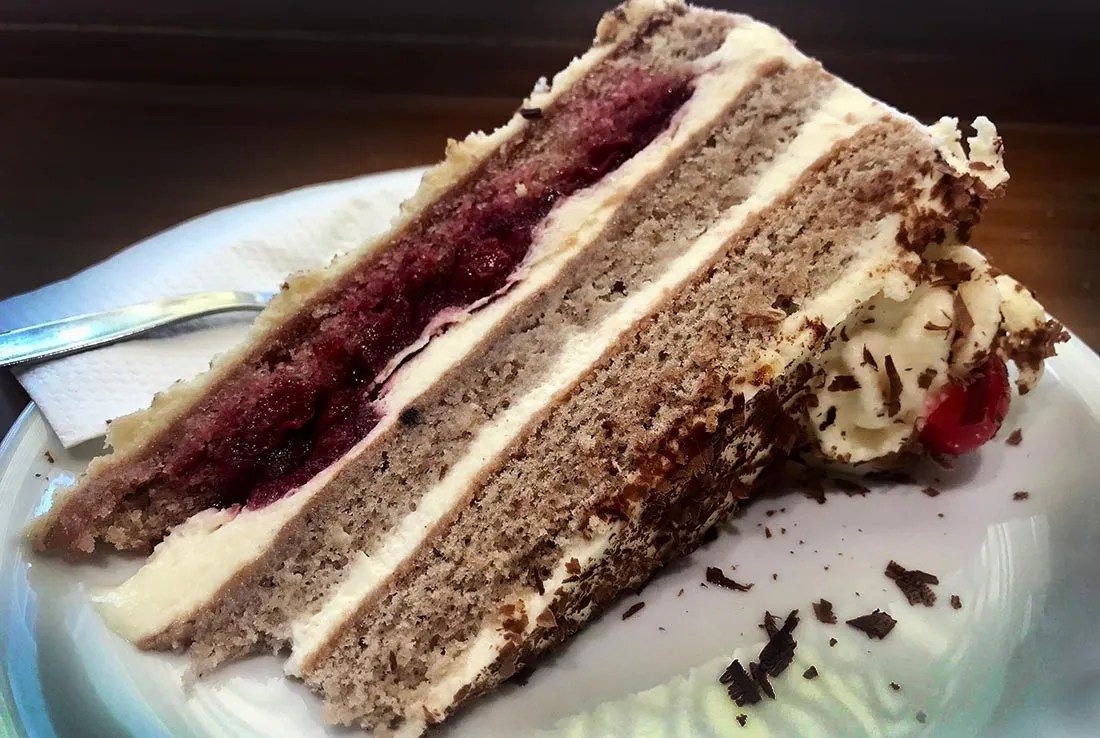 A slice of Black Forest Cake includes layers of chocolate cake, buttercream, and tart cherries laced with Kirschwasser.