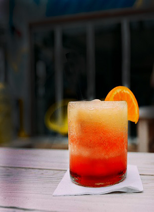 An OBX Dreamsicle cocktail made with Kill Devil Gold Rum, garnished with a orange wedge.