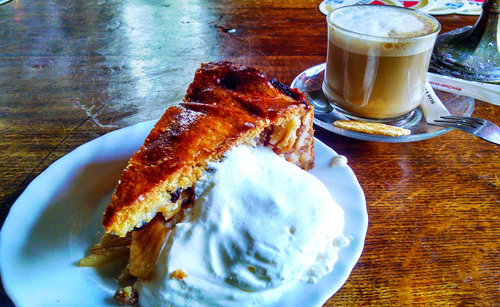 The apple pie with whipped cream at Cafe Papeneiland, some of the best in town, and a perfect way to begin your Amsterdam food tour. Yes. Life is short; eat dessert first.