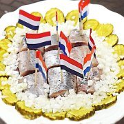 Raw herring, with pickles and onion, one of the national dishes of the Netherlands available on an Eating Europe food tour in Amsterdam