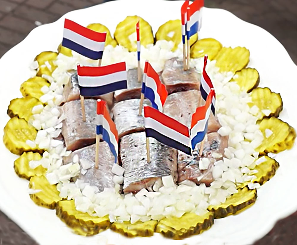 Herring! You can't have an Amsterdam food tour without herring, shown here in chunks speared with Amsterdam flag toothpicks, surrounded by chopped onion and pickle slices.